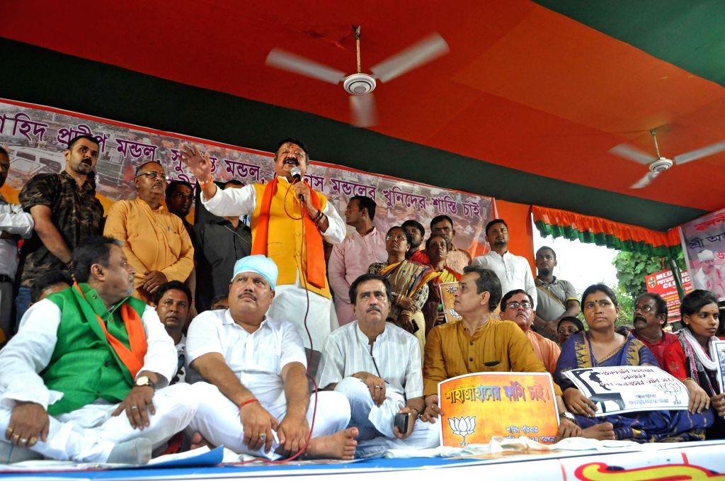 BJP National Secretary Kailash Vijayvargiya addresses during a demonstration against Sandeshkhali killings, in Kolkata on Sep 4, 2019. Also seen BJP leaders Mukul Roy and Arjun Singh. - Mukul Roy and Arjun Singh