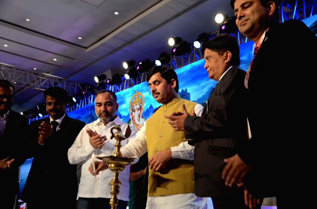 BJP national spokesperson Syed Shahnawaz Hussain, Gems and Jewellery Export Promotion Council, (GJEPC) Chairman Pramod Agarwal and other dignitaries during the inauguration of Manthan 2018 ...