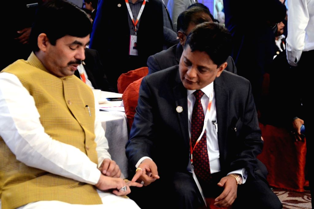 BJP national spokesperson Syed Shahnawaz Hussain in a conversation with Gems and Jewellery Export Promotion Council, (GJEPC) Chairman Pramod Agarwal during Manthan 2018 – a gem and ...