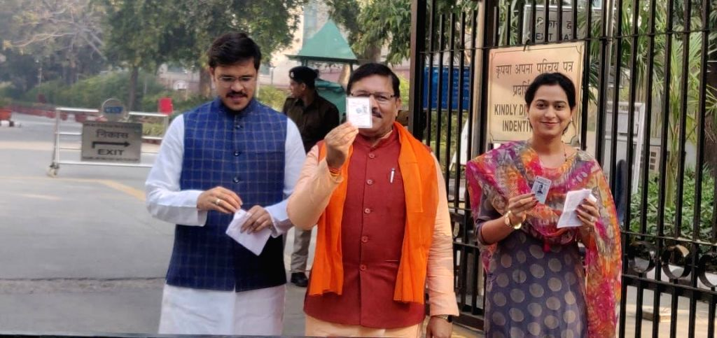 BJP National Vice President Shyam Jaju shows his Voter ID as he arrives to cast his vote for the Delhi Assembly elections 2020, at a polling booth in New Delhi on Feb 8, 2020. - Shyam Jaju