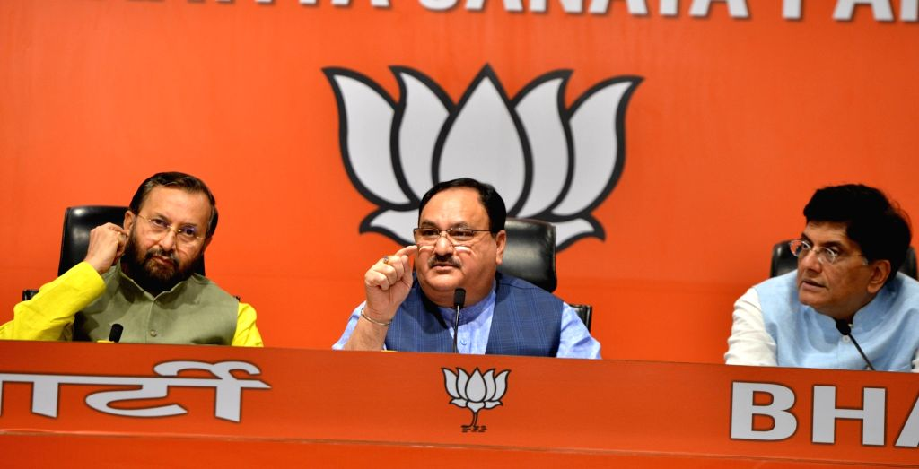 BJP National Working President J.P. Nadda accompanied by Union Ministers Prakash Javadekar and Piyush Goyal, addresses a press conference at the party's headquarters in New Delhi on July ... - Prakash Javadekar and Piyush Goyal