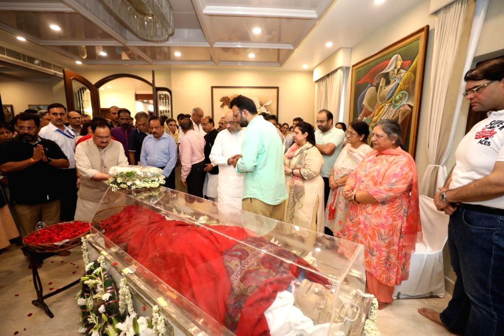 BJP National Working President J.P. Nadda pays tributes to Former Finance Minister Arun Jaitley at his residence, in New Delhi on Aug 24, 2019. Also seen Union Ministers Amit Shah and ... - Arun Jaitley, Ministers Amit Shah and Harsh Vardhan