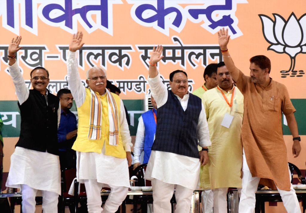 BJP National Working President J.P. Nadda with Haryana Chief Minister Manohar Lal Khattar and party leaders Anil Jain and Subhash Barala at BJP's core committee meeting in Rohtak on July 27, ... - Manohar Lal Khattar and Jain