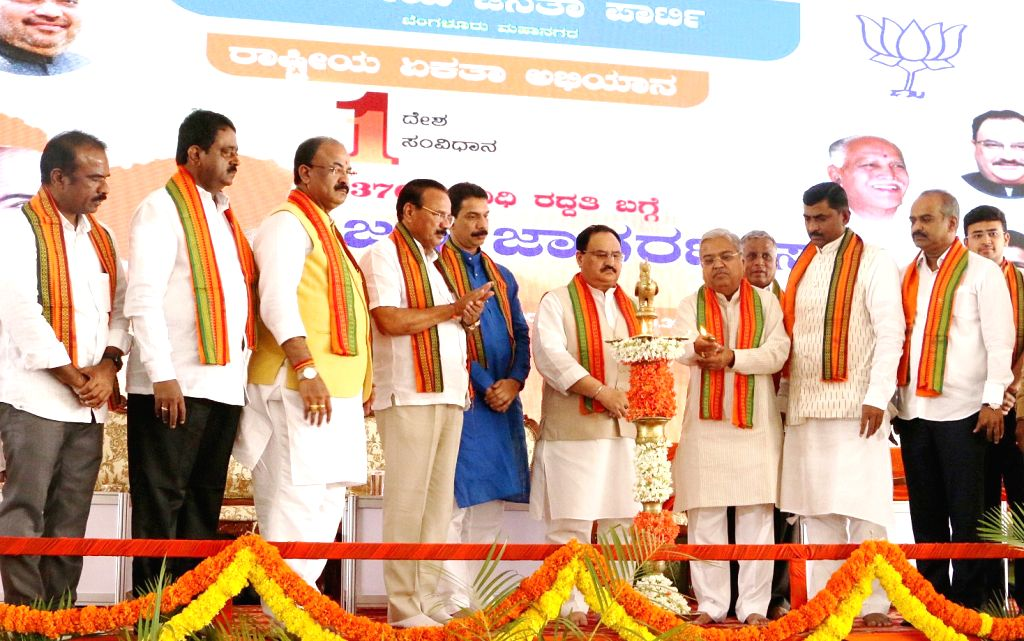 "BJP National Working President JP Nadda lights the lamp to inaugurate ""One Nation One Constituency"" progaram at Palace Grounds, in Bengaluru on Sep 22, 2019. Union Minister DV ... - Muralidhar Rao and Nalin Kumar Kateel"