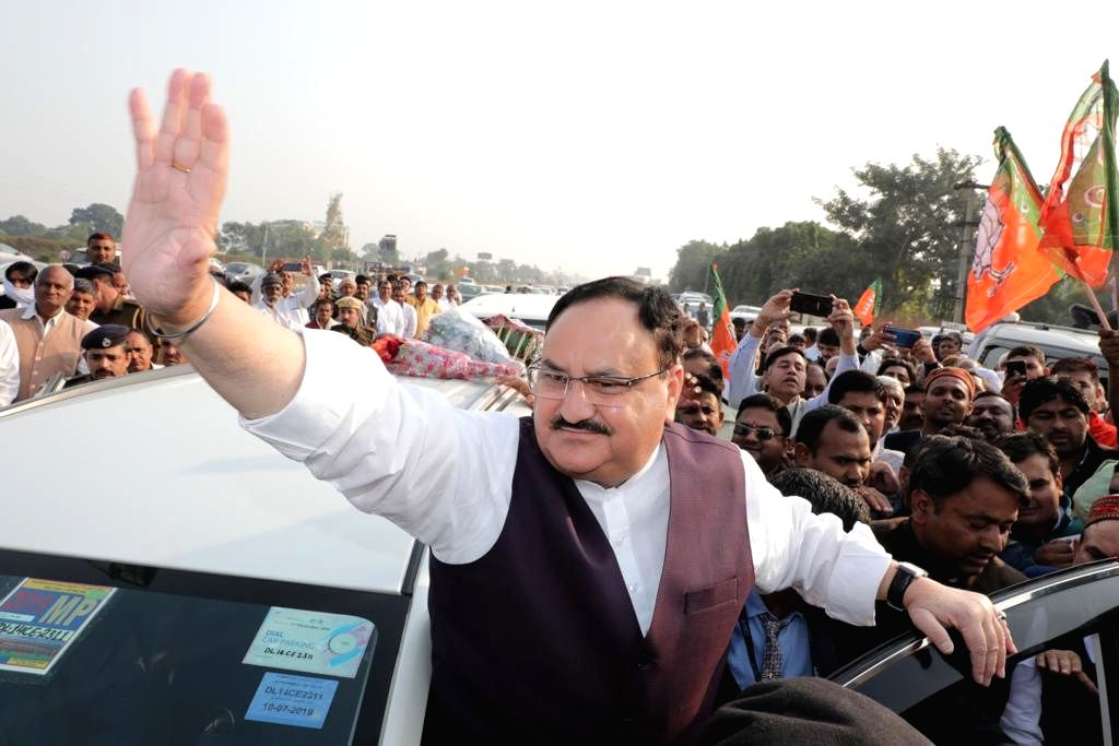 BJP National Working President JP Nadda receives warm welcome from party workers and supporters on his way to attend 'Geeta Jayanti Mahotsav' in Kurukshetra, Haryana on Dec 7, 2019.