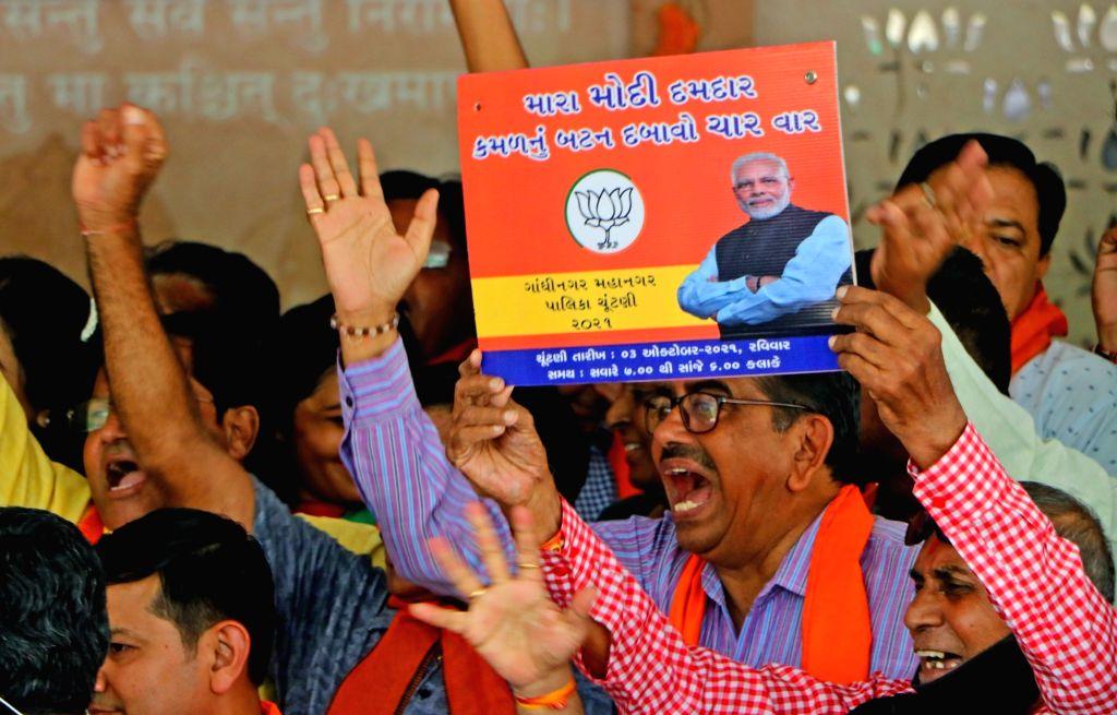 BJP party  supporters celebrate after winning  Gandhinagar Municipal Election at BJP headquarter in Gandhinagar on Tuesday October 05,2021,(PHOTO:Siddharaj Solanki/IANS)