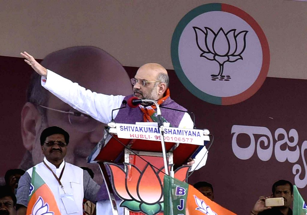 BJP President Amit Shah addresses at a OBC convention in Haveri district of Karnataka on April 3, 2018. - Amit Shah