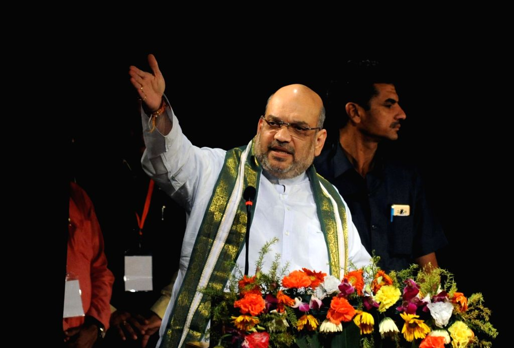 BJP president Amit Shah addresses during a meeting with intellectuals and party workers in Kolkata on Sept 12, 2017. - Amit Shah