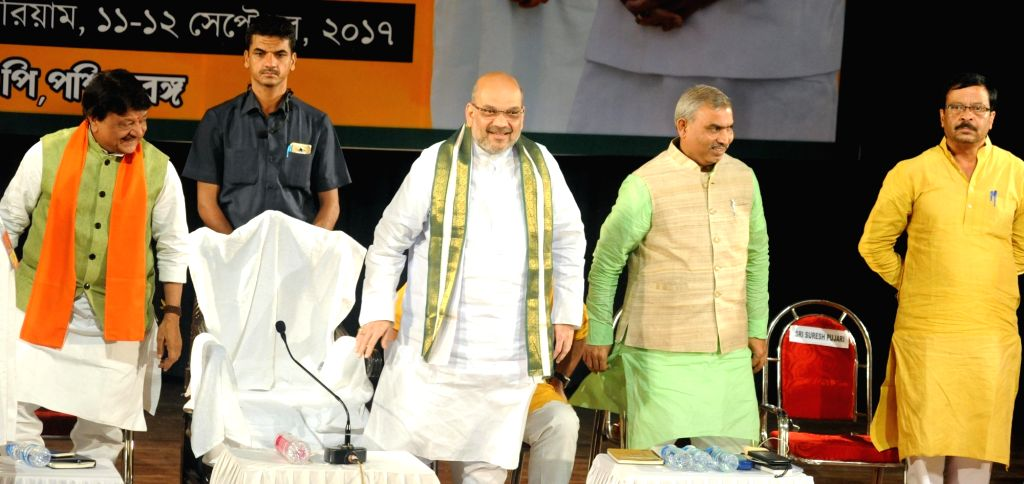 BJP president Amit Shah along with party leaders during a meeting with intellectuals and party workers in Kolkata on Sept 12, 2017. - Amit Shah