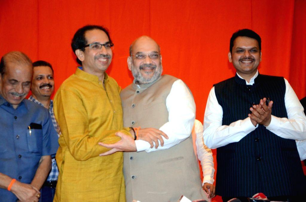 BJP President Amit Shah and Sena President Uddhav Thackeray, along with Maharashtra Chief Minister and BJP leader Devendra Fadnavis during a joint media briefing regarding BJP-Shiv Sena ... - Amit Shah