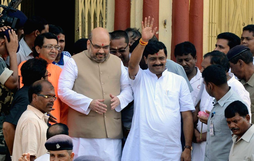BJP president Amit Shah and West Bengal BJP chief Rahul Sinha during their visit to Kali temple in Dakshineswar of West Bengal's North 24 Parganas on Sept 7, 2014. - Rahul Sinha