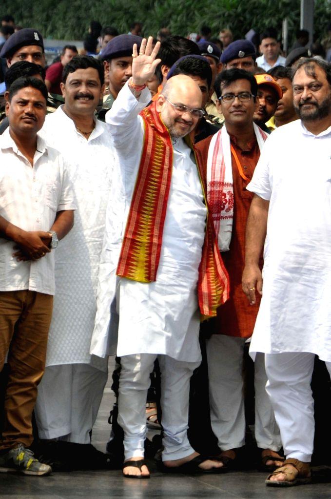 BJP president Amit Shah arrives at Netaji Subhas Chandra Bose International (NSCBI) Airport on his way back to Delhi, in Kolkata on Sept 13, 2017. - Amit Shah