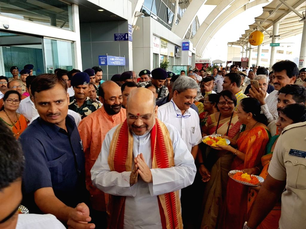 BJP president Amit Shah being welcomed by Goa Chief Minister Manohar Parrikar at Dabolim airport on July 1, 2017. - Manohar Parrikar and Amit Shah