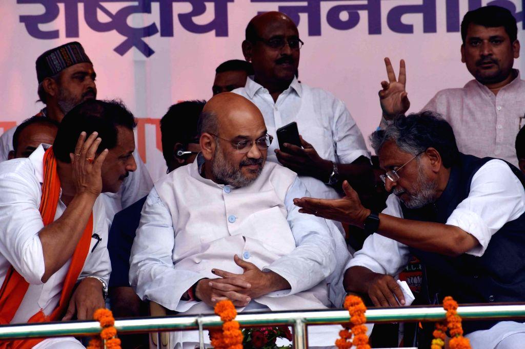 BJP President Amit Shah, Bihar Deputy Chief Minister Sushil Kumar Modi and former Union Minister Rajiv Pratap Rudy during an election campaign rally for ahead of Lok Sabha polls, in Chhapra ... - Sushil Kumar Modi and Amit Shah