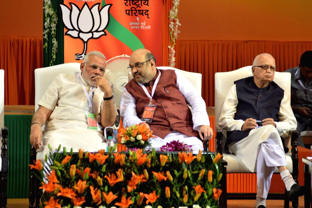 BJP President Amit Shah in consultation with Prime Minister Narendra Modi during the BJP National Council meeting in New Delhi on Aug. 9, 2014. - Narendra Modi