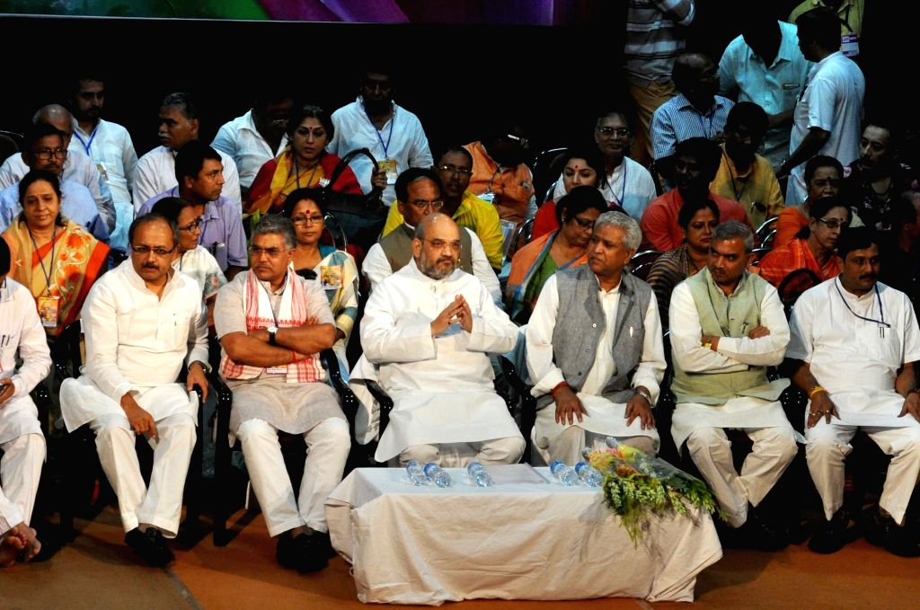 BJP president Amit Shah, party's state Chief Dilip Ghosh, leader Siddharth Nath Singh during Party's Parishad Sammelan in Kolkata on Aug 3, 2016. - Amit Shah, Dilip Ghosh and Siddharth Nath Singh