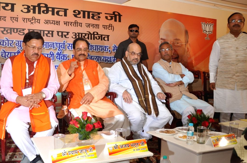 BJP President Amit Shah, Uttarakhand Chief Minister Trivendra Singh Rawat, State BJP President Ajay Bhatt and State BJP incharge Shyam Jaju duriung a meeting in Dehradun on Sept 19, 2017. - Trivendra Singh Rawat and Amit Shah