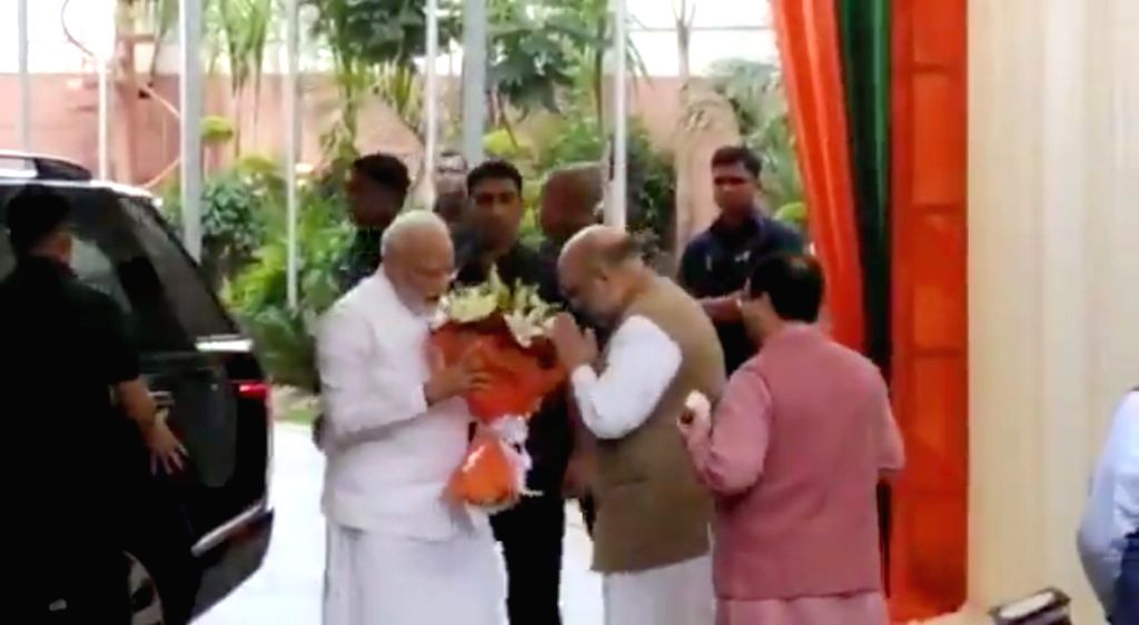 BJP President Amit Shah welcomes Prime Minister Narendra Modi on his arrival at the BJP's Central Election Committee (CEC) meeting where candidates for Maharashtra and Haryana assembly ... - Narendra Modi and Amit Shah