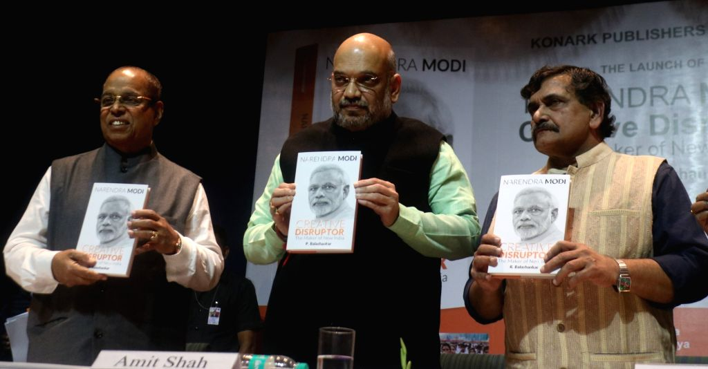 """BJP President Amit Shah with author Dr. R. Balashankar at the release of the book """"Narendra Modi : Creative Disruptor"""" in New Delhi on Dec 10, 2018. - Narendra Modi and Amit Shah"""