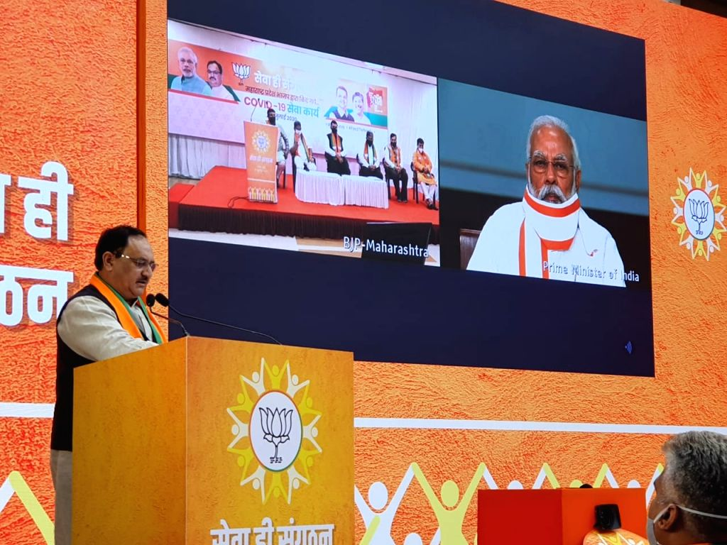BJP President JP Nadda addresses ahead of Prime Minister Narendra Modi's address to review the relief work done by BJP workers during corona crisis through video conferencing, in New ... - Narendra Modi