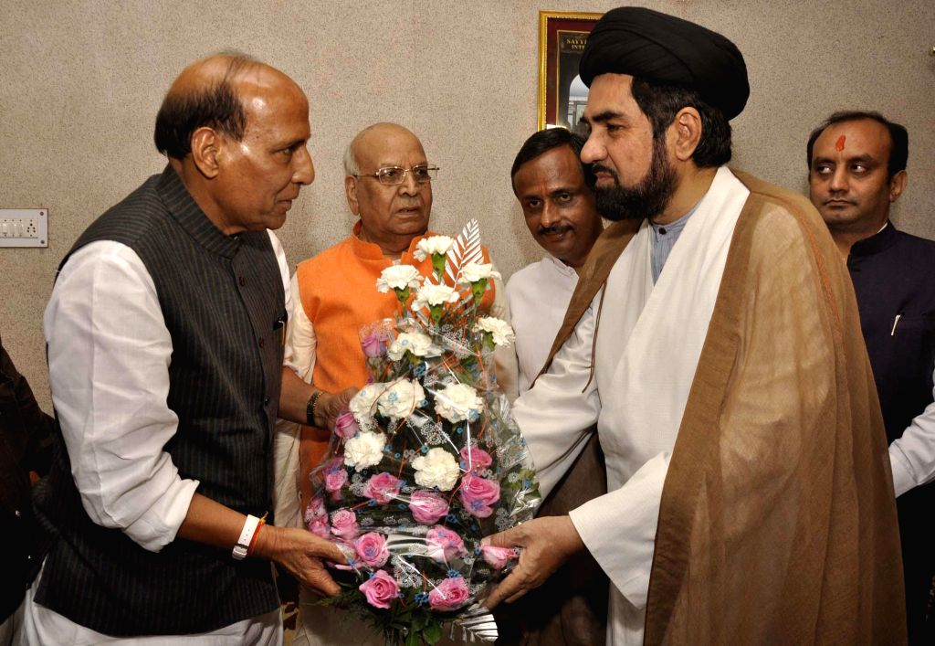 BJP president Rajnath Singh with Shia cleric Maulana Kalbe Sadiq during a meeting in Lucknow on April 15, 2014.