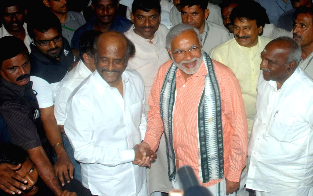 BJP Prime Ministerial candidate and Gujarat Chief Minister Narendra Modi  with actor Rajnikanth during a meeting at the actor's residence in Chennai on April 13, 2014.
