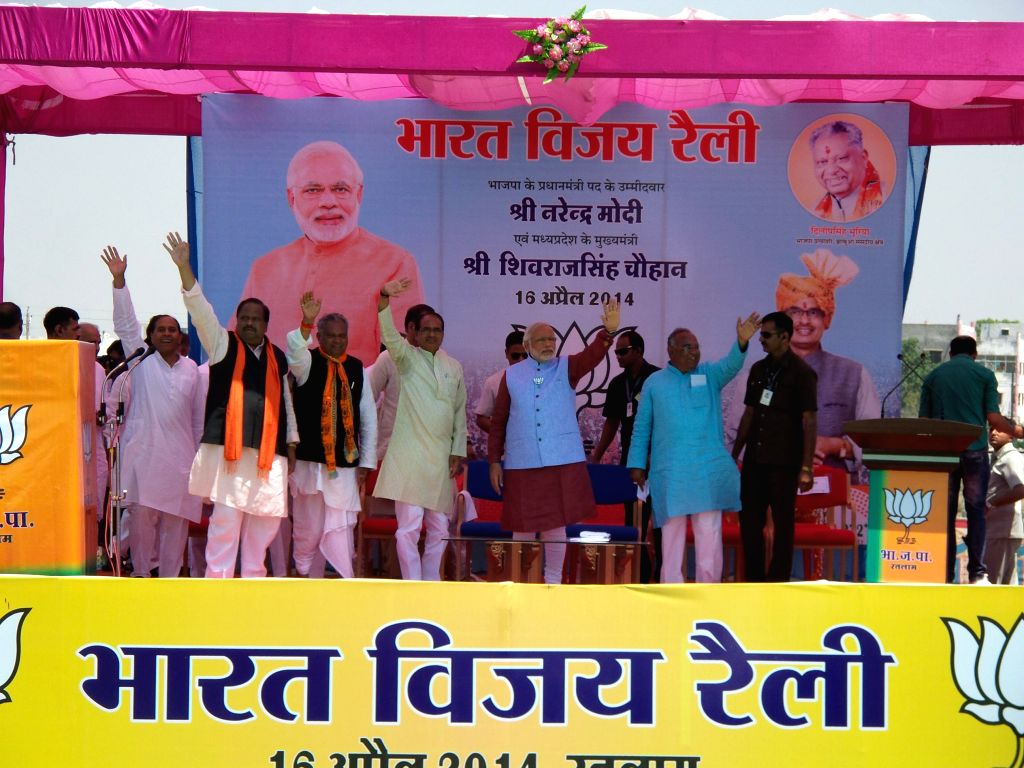 BJP Prime Ministerial candidate and Gujarat Chief Minister Narendra Modi with Madhya Pradesh Chief Minister Shivraj Singh Chouhan and others during a rally in Ratlam district of Madhaya Pradesh on ... - Shivraj Singh Chouhan