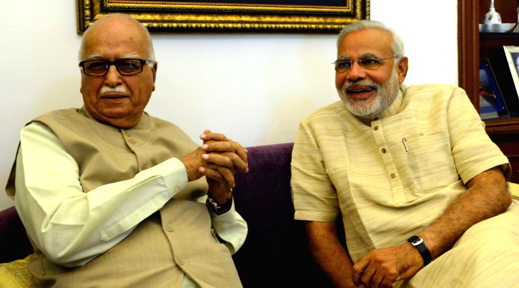 BJP Prime Ministerial candidate Narendra Modi during a meeting with party veteran L K Advani in New Delhi on May 18, 2014.
