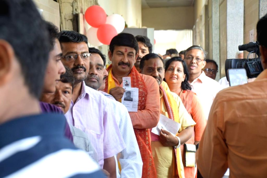 BJP's candidate for Northeast Delhi, Manoj Tiwari stands in a queue to cast his vote during the sixth phase of 2019 Lok Sabha elections, in New Delhi on May 12, 2019.