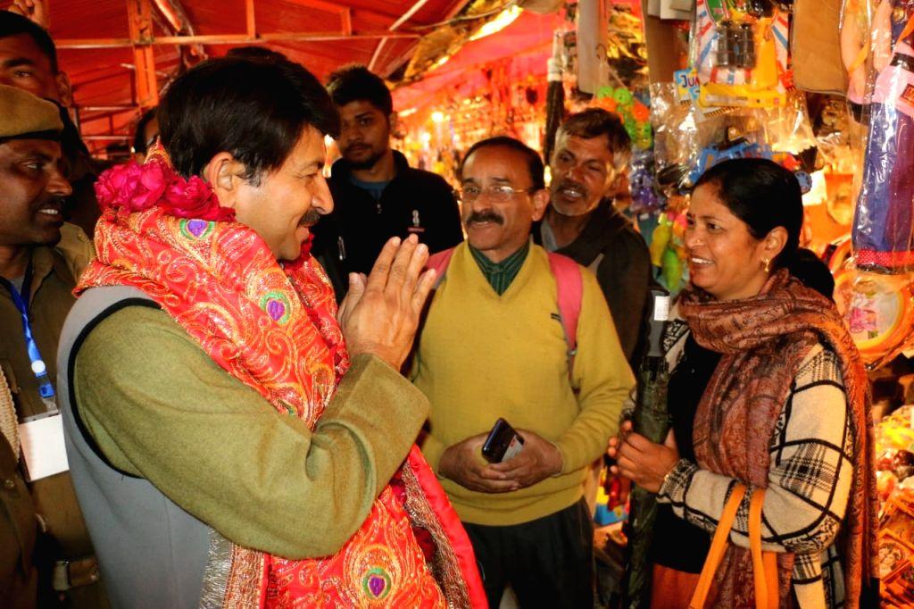 BJP's Delhi Chief Manoj Tiwari visits the Hanuman Temple in Delhi's Kalkaji on Feb 7, 2020.