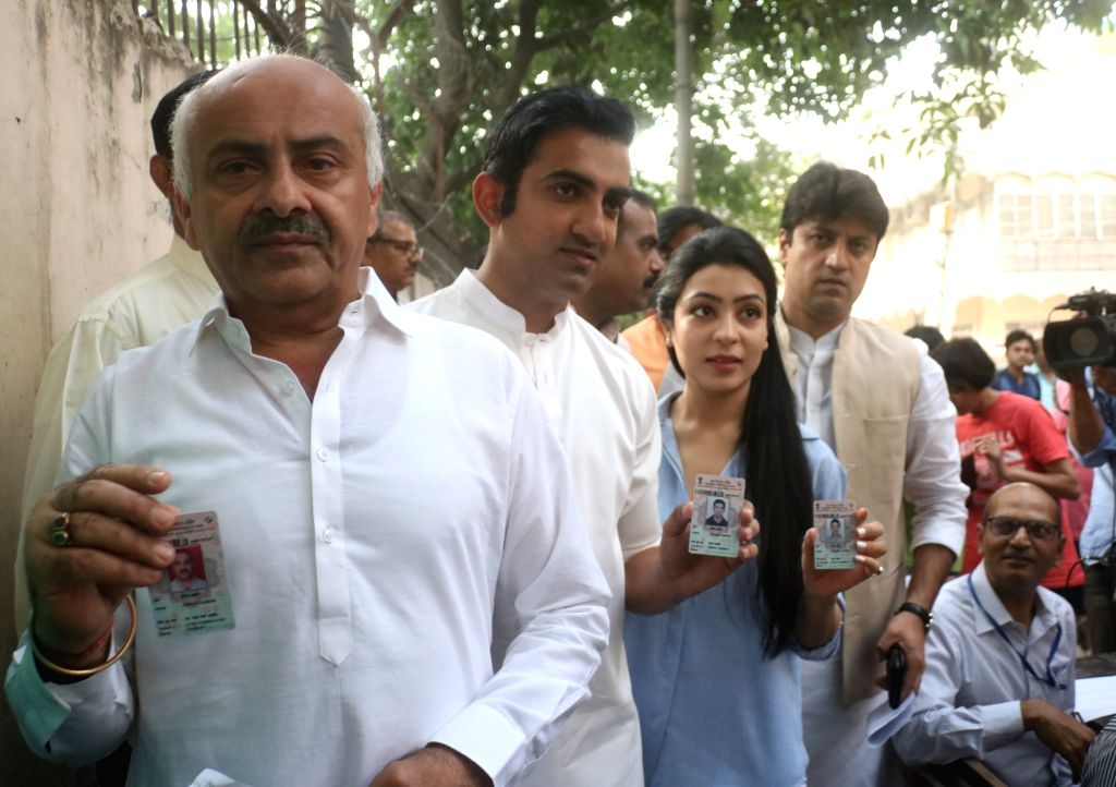 BJP's Lok Sabha candidate for East Delhi, Gautam Gambhir and his wife queue up to cast their votes during the sixth phase of 2019 Lok Sabha elections, in New Delhi on May 12, 2019.