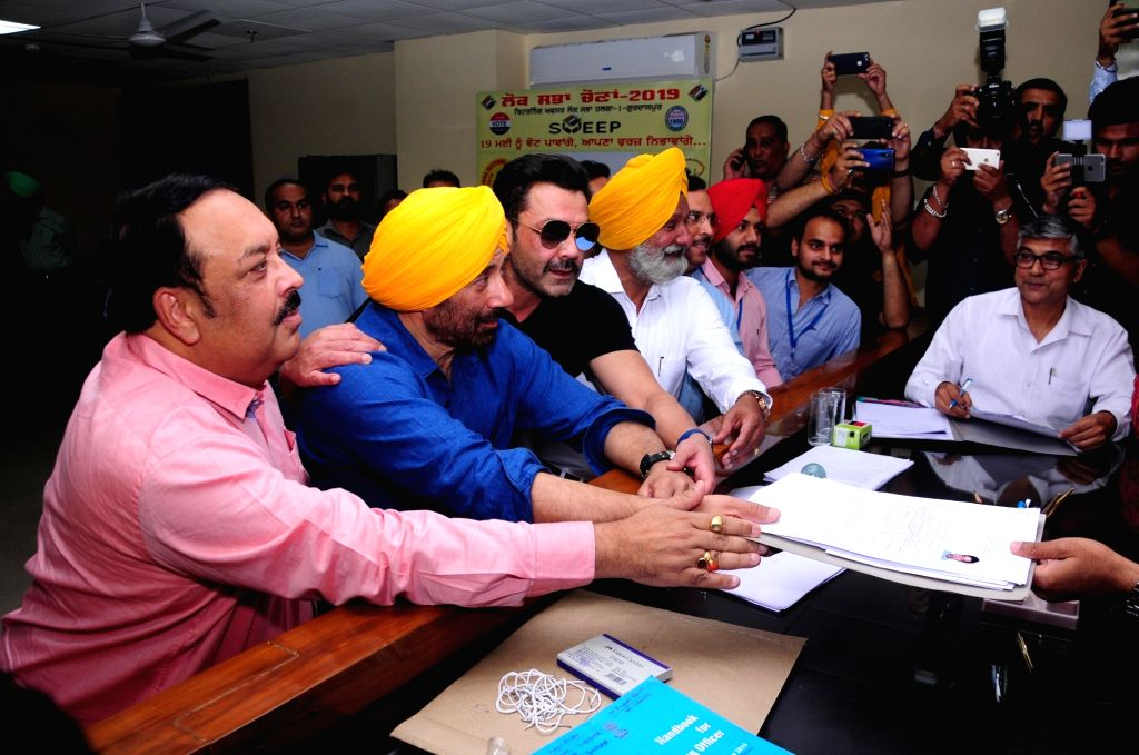 BJP's Lok Sabha candidate from Gurdaspur Sunny Deol accompanied by Punjab BJP chief Shwet Malik and actor Bobby Deol, files nomination for the forthcoming Lok Sabha elections in Punjab's ... - Bobby Deol and Malik