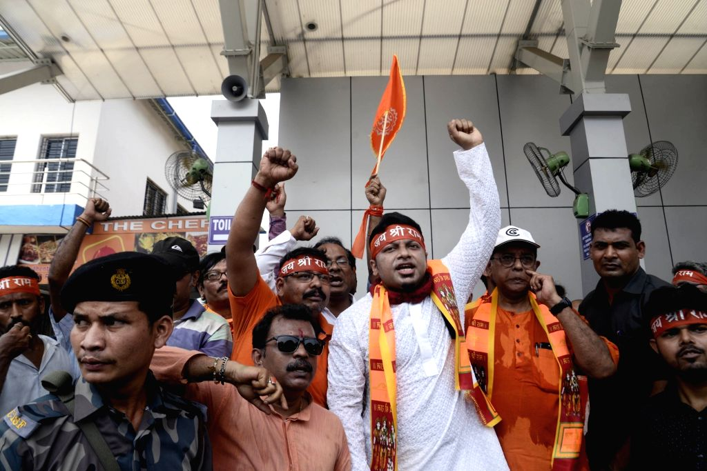 BJP's Lok Sabha candidate from Jadavpur, Anupam Hazra accompanied by supporters, participates in a religious procession during Ram Navami celebrations, in Kolkata on April 13, 2019.