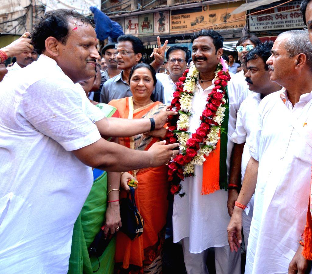 BJP's Lok Sabha candidate from North Kolkata, Rahul Sinha arrives to file his nomination for the forthcoming Lok Sabha elections, in Kolkata on April 25, 2019. - Rahul Sinha