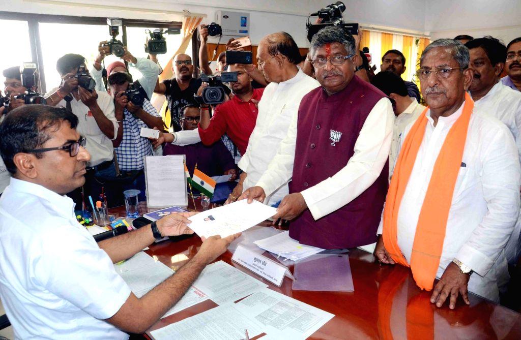 BJP's Lok Sabha candidate from Patna Sahib, Ravi Shankar Prasad accompanied by Bihar Minister and BJP leader Nand Kishore Yadav, files his nomination for the forthcoming Lok Sabha polls, in ... - Nand Kishore Yadav