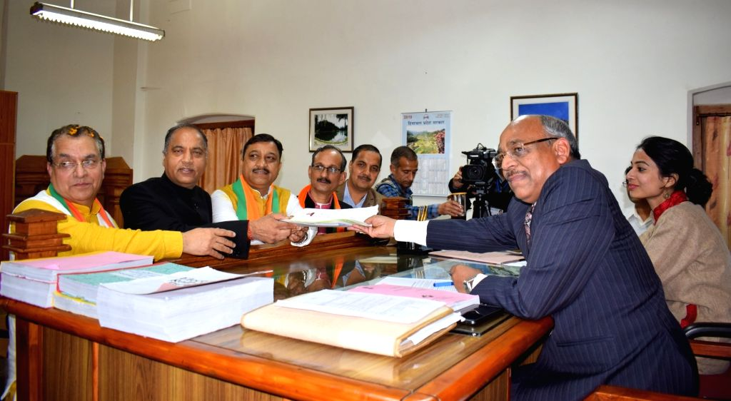 BJP's Lok Sabha candidate from Shimla, Suresh Kashyap accompanied by Himachal Pradesh Chief Minister Jai Ram Thakur, files his nomination for the forthcoming Lok Sabha elections, in Shimla on ... - Jai Ram Thakur and Suresh Kashyap