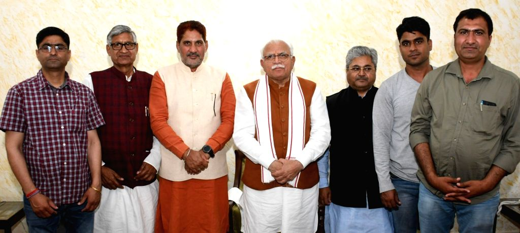 BJP's newly elected Rajya Sabha Members Ramchander Jangra and Dushyant Kumar Gautam call on Haryana Chief Minister Manohar Lal Khattar and state party president Subhash Barala, in ... - Manohar Lal Khattar and Dushyant Kumar Gautam