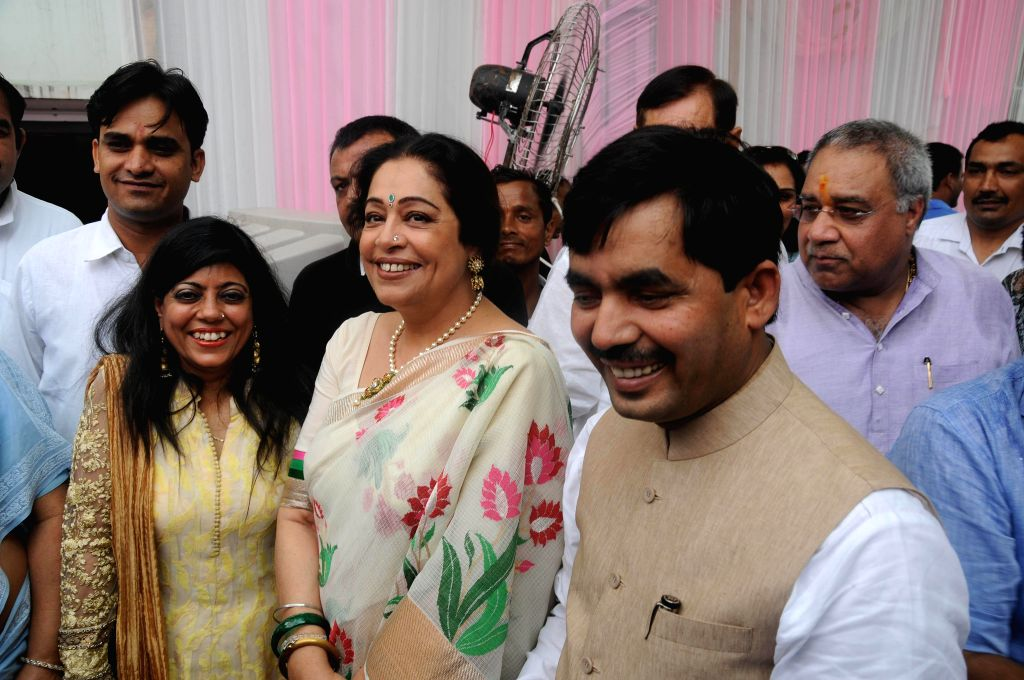 BJP senior leader Shahnawaz Hussain and his wife Renu(L) and party's MP Kirron Kher(M) during Eid celebration at his residence in New Delhi on July 29, 2014. - Kirron Kher