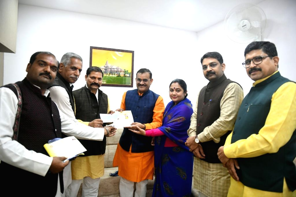 BJP state president and his wife paid one day's salary for temple construction.