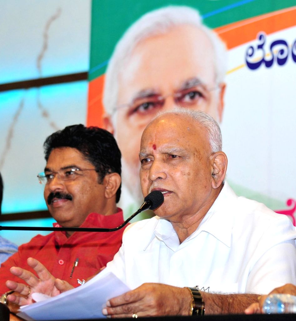 BJP State President B. S. Yeddyurappa along with party leader R. Ashok, addresses a press conference in Bengaluru, on March 13, 2019.