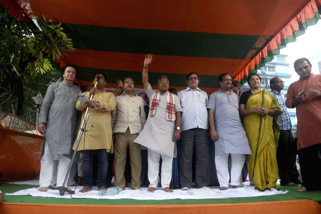 BJP state president Dilip Ghosh along with state secretary Locket Chatterjee during a demonstration in Kolkata on Aug 12, 2017. - Dilip Ghosh and Chatterjee