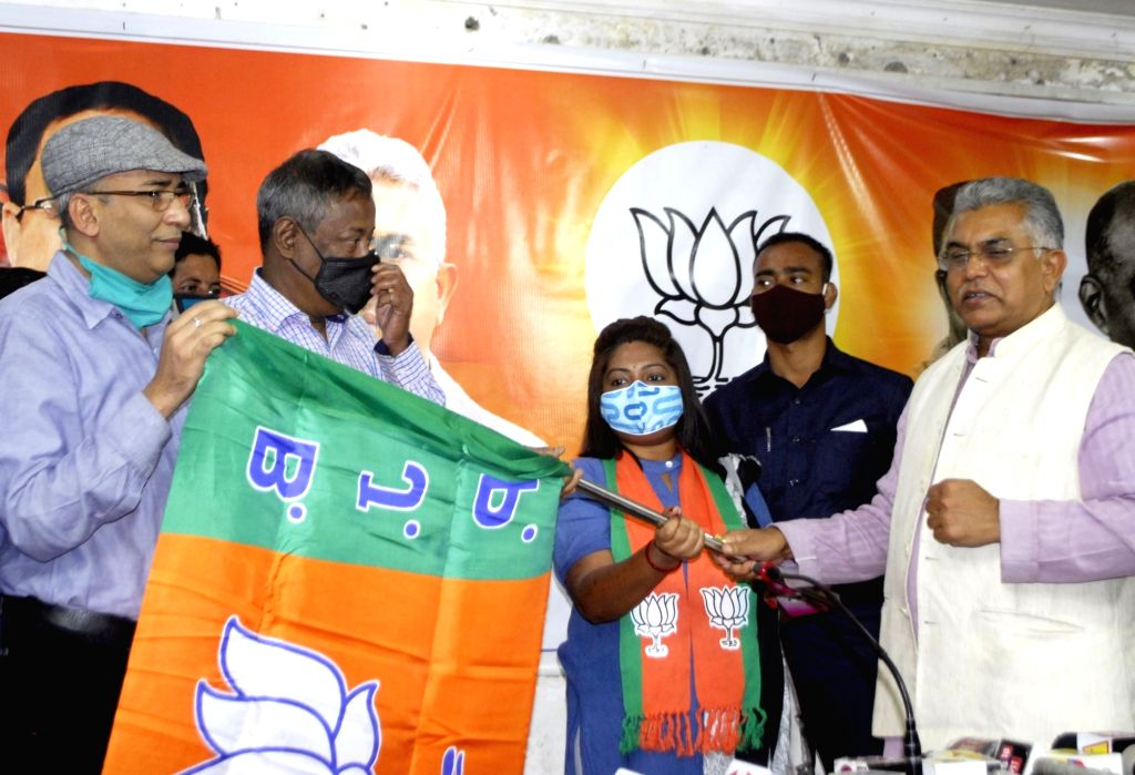 BJP State President Dilip Ghosh handed over party flag to newly joinee from CPI(M) party in Kolkata on Nov 29, 2020. - Dilip Ghosh