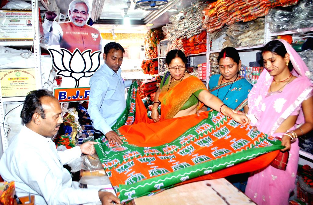 BJP supporters buy 'BJP Sarees' with lotuses printed on them in Allahabad on April 11, 2014.