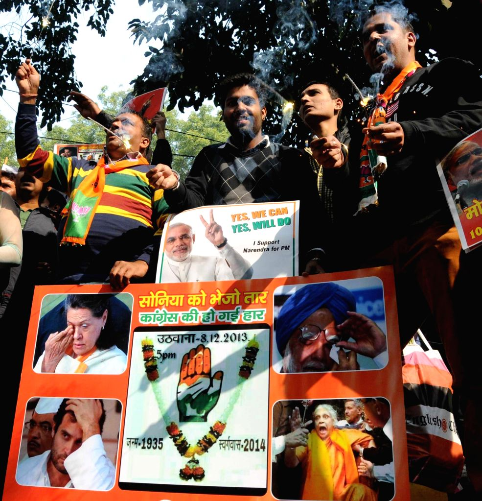 BJP supporters celebrate after declaration of Delhi Assembly Polls results in New Delhi on Dec.8, 2013.