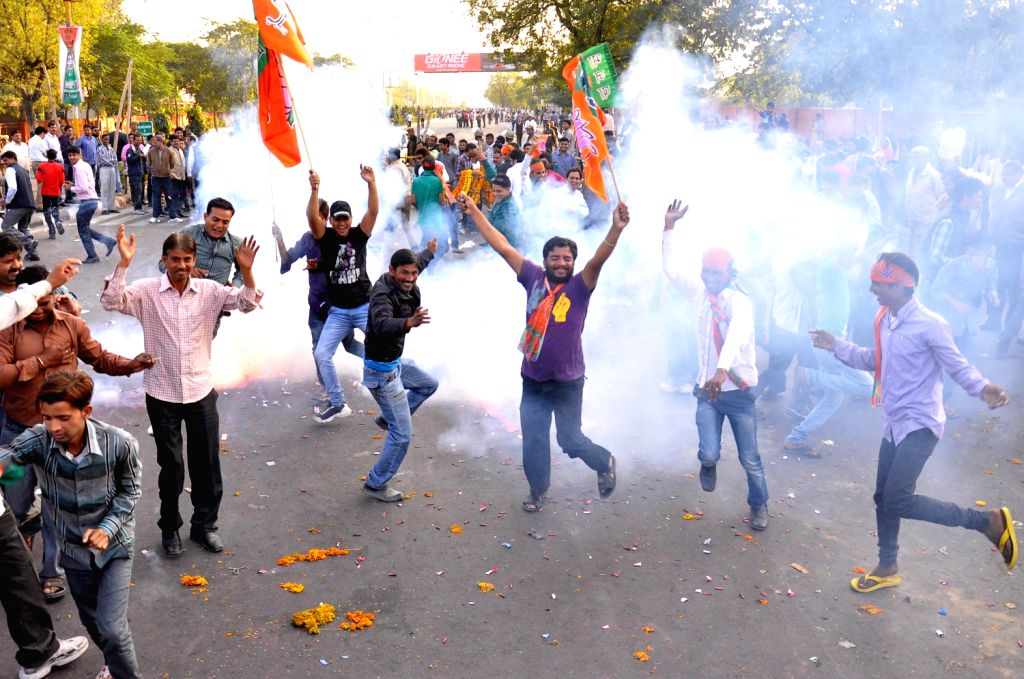 BJP supporters celebrate after declaration of Rajasthan Assembly Polls result in Jaipur on Dec.8, 2013.