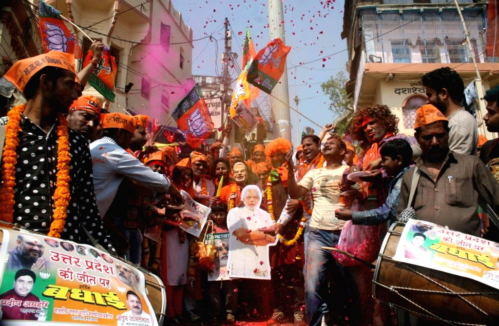 BJP supporters celebrate as assembly election results being announced in Varanasi on March 11, 2017.