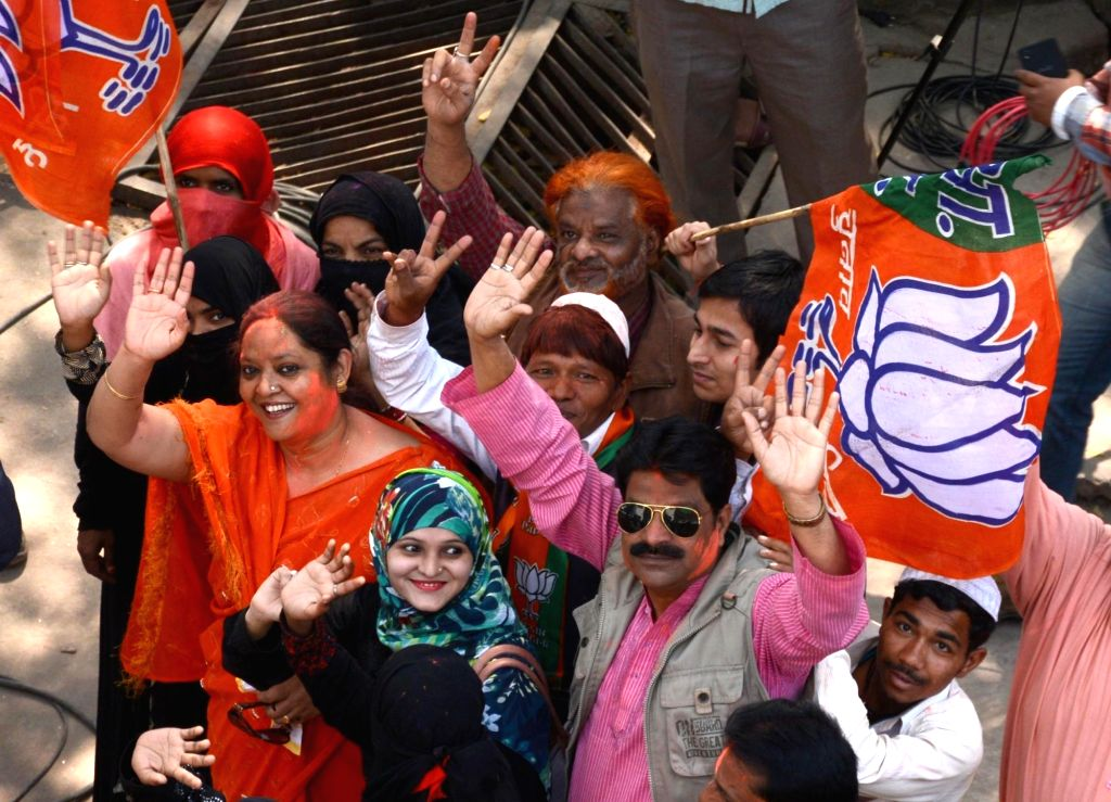 BJP supporters celebrate as assembly election results being announced in Lucknow on March 11, 2017.