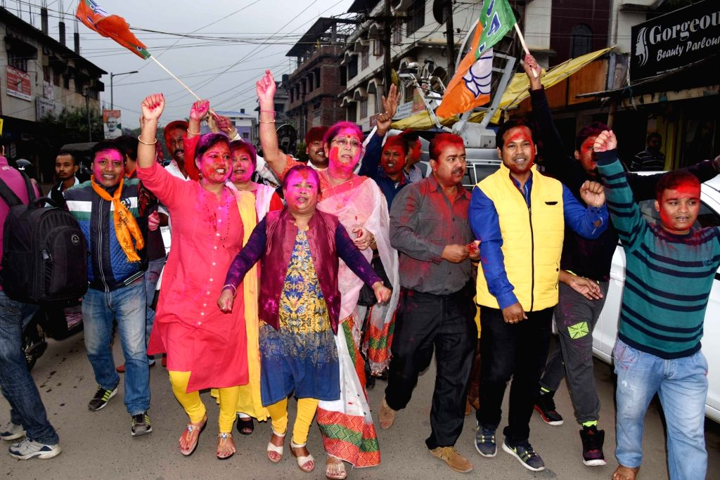 BJP supporters celebrate as assembly election results being announced in Guwahati on March 11, 2017.