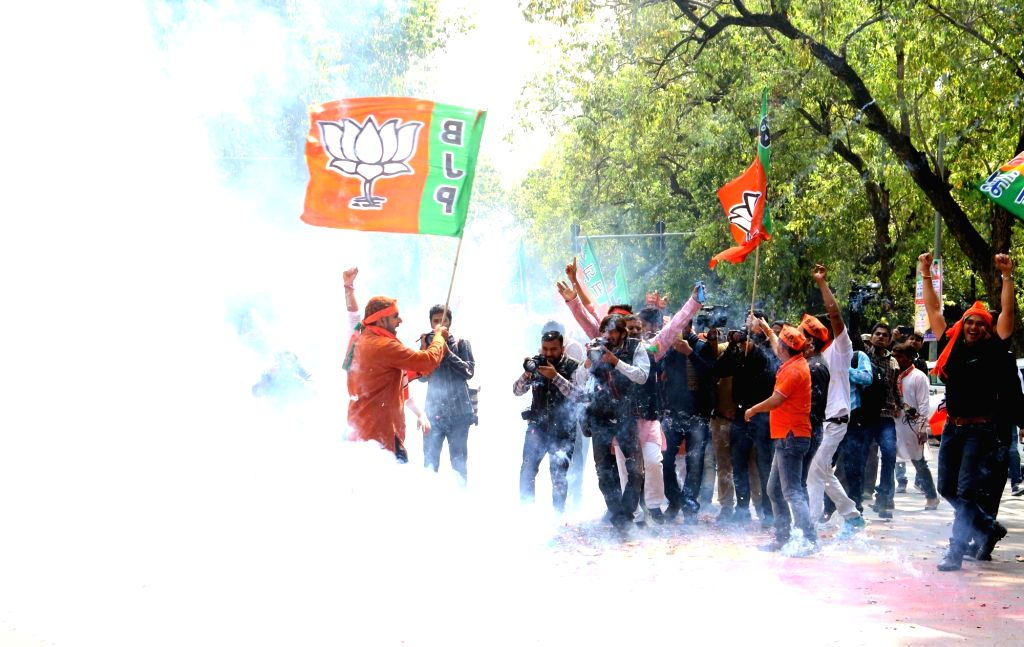 BJP supporters celebrate as assembly election results being announced at BJP office in New Delhi on March 11, 2017.