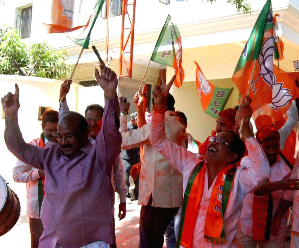 BJP supporters celebrate as assembly election results being announced at BJP office in Hyderabad on March 11, 2017.